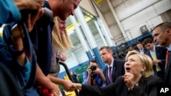 Democratic presidential candidate Hillary Clinton reacts while greeting supporters after giving a speech on the economy at Futuramic Tool & Engineering, in Warren, Mich., Aug. 11, 2016.