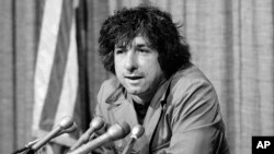 FILE - political activist Tom Hayden, husband of actress Jane Fonda, speaks to the press in Los Angeles, California, Dec. 6, 1973. Hayden and Fonda made a trip to North Vietnam in protest of the U.S. involvement in the war against Hanoi.