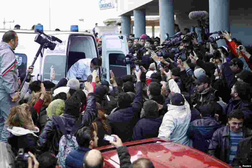 The body of Shokri Belaid, a prominent Tunisian opposition politician, is carried into an ambulance after he was shot, in Tunis.