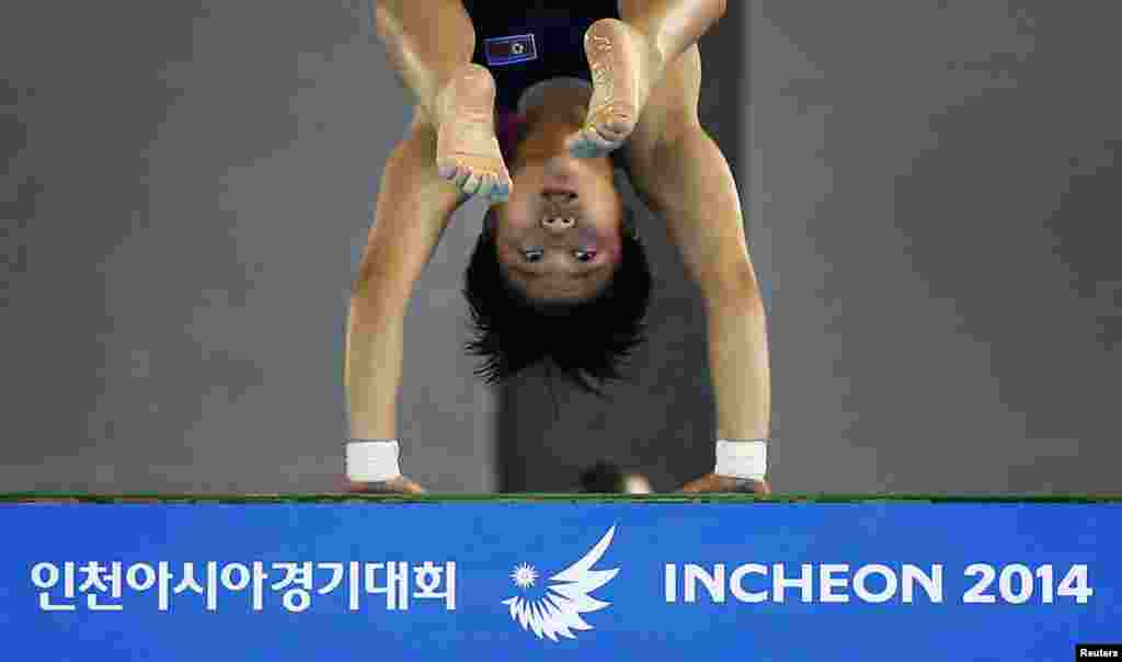 North Korea's Song Namhyang competes in the Women's 10m platform diving final at the Munhak Park Tae-hwan Aquatics Center during the 17th Asian Games in Incheon, South Korea.