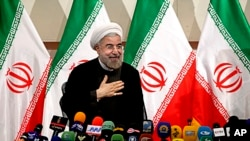 Iran's President - elect Hasan Rowhani, after speaking at a press conference, in Tehran, June 17, 2013.