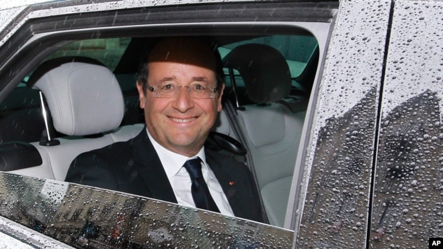French President Francois Hollande reacts after leaving a restaurant in Tulle, central France, June 10, 2012.