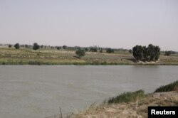 FILE - A view of the Euphrates River from al-Bugilia, north of Deir el-Zour, Syria, Sept. 21, 2017.