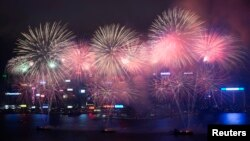 Fireworks explode over Victoria Harbour to celebrate the Chinese Lunar New Year in Hong Kong February 11, 2013.