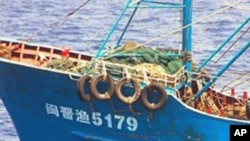 A handout picture released from Japan Coast Guard on 8 Sept. 2010 shows a Chinese fishing boat, which was seized by Japan Coast Guard's patrol boat near a disputed island a day before.