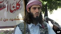 American born Islamist militant fighter Omar Hamammi, known as Abu Mansur Al-Amriki, adresses a press conference at a farm in southern Mogadishu's Afgoye district, Somalia, May 11, 2011.
