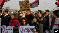 Pakistani civil society activists condemn the attack on Bacha Khan University, in Islamabad, Pakistan, Jan. 21, 2016.