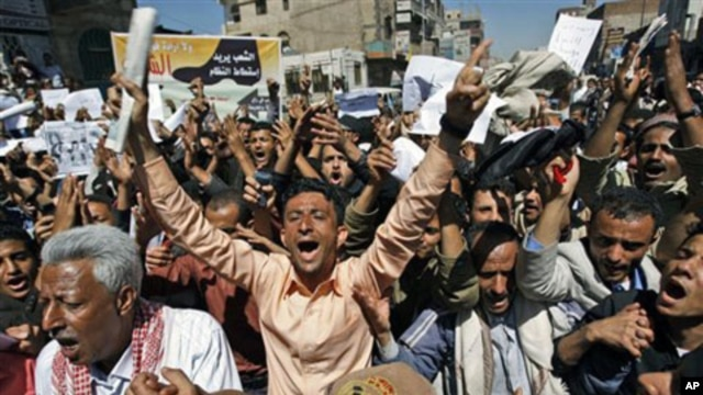 Yemeni anti-government protesters shout slogans during a demonstration demanding the resignation of President Ali Abdullah Saleh, in Sana'a, February 15, 2011