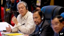 FILE - Philippine Foreign Secretary Perfecto Yasay, left, who was standing in for Philippine President Rodrigo Duterte, attends the ASEAN-U.S. summit at the National Convention Center in Vientiane, Laos, Sept. 8, 2016.