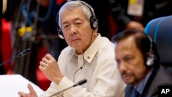 Philippines Secretary of Foreign Affairs Perfecto Yasay, left, who was standing in for Philippine's President Rodrigo Duterte attends the ASEAN-U.S. summit, a parallel summit in the ongoing 28th and 29th ASEAN Summits and other related summits at National
