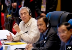 Philippines Secretary of Foreign Affairs Perfecto Yasay, left, who was standing in for Philippine's President Rodrigo Duterte attends the ASEAN-U.S. summit, a parallel summit in the ongoing 28th and 29th ASEAN Summits and other related summits.