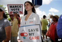 Medical student Rebecca Tanenbaum protests agains the current GOP health care bill outside of the office of Sen. Marco Rubio, R-Fla., June 28, 2017, in Miami.