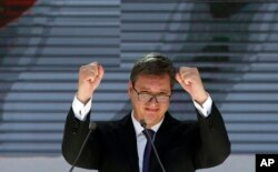 FILE - Serbian President Aleksandar Vucic gestures during a rally in the northern, Serb-dominated part of Mitrovica, Kosovo, Sept. 9, 2018.