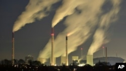 FILE - Smoke streams from the chimneys of the E.ON coal-fired power station in Gelsenkirchen, Germany, Nov. 24, 2014.