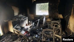 An interior view of the damage at the U.S. consulate, which was attacked and set on fire by gunmen in Benghazi on September 12, 2012. Christopher Stevens, the U.S. ambassador to Libya, and three embassy staff were killed as they rushed away from the consulate building, stormed by al Qaeda-linked gunmen.