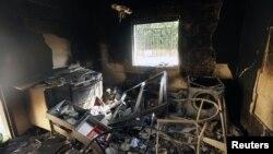 Konsulat AS yang rusak karena serangan pasukan bersenjata di Benghazi, Libya. (Foto: Dok)