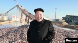 FILE - North Korea's leader Kim Jong Un visits a Korean People's Army fishery station.