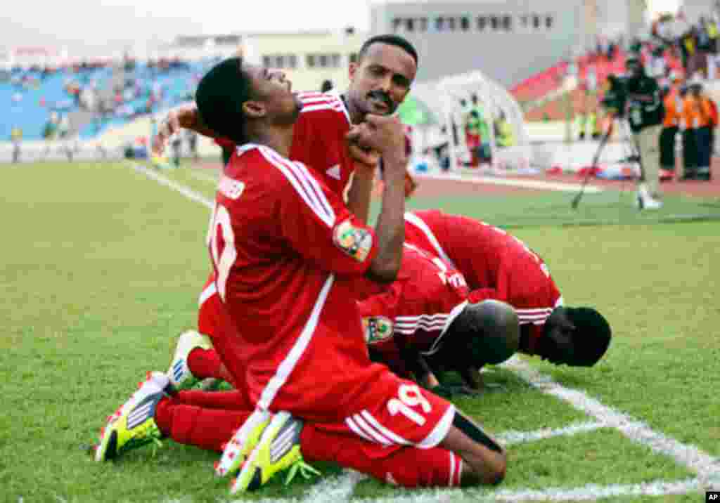 Sudan's Bashir celebrates with teammates after scoring against Angola during their African Nations Cup soccer match in Malabo