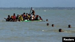 Rohingya refugees arriving on a makeshift boat