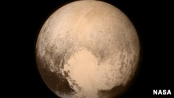 Pluto nearly fills the frame in this image from the Long Range Reconnaissance Imager (LORRI) aboard NASA's New Horizons spacecraft, taken on July 13, 2015, when the spacecraft was 476,000 miles (768,000 kilometers) from the surface. This is the last and m