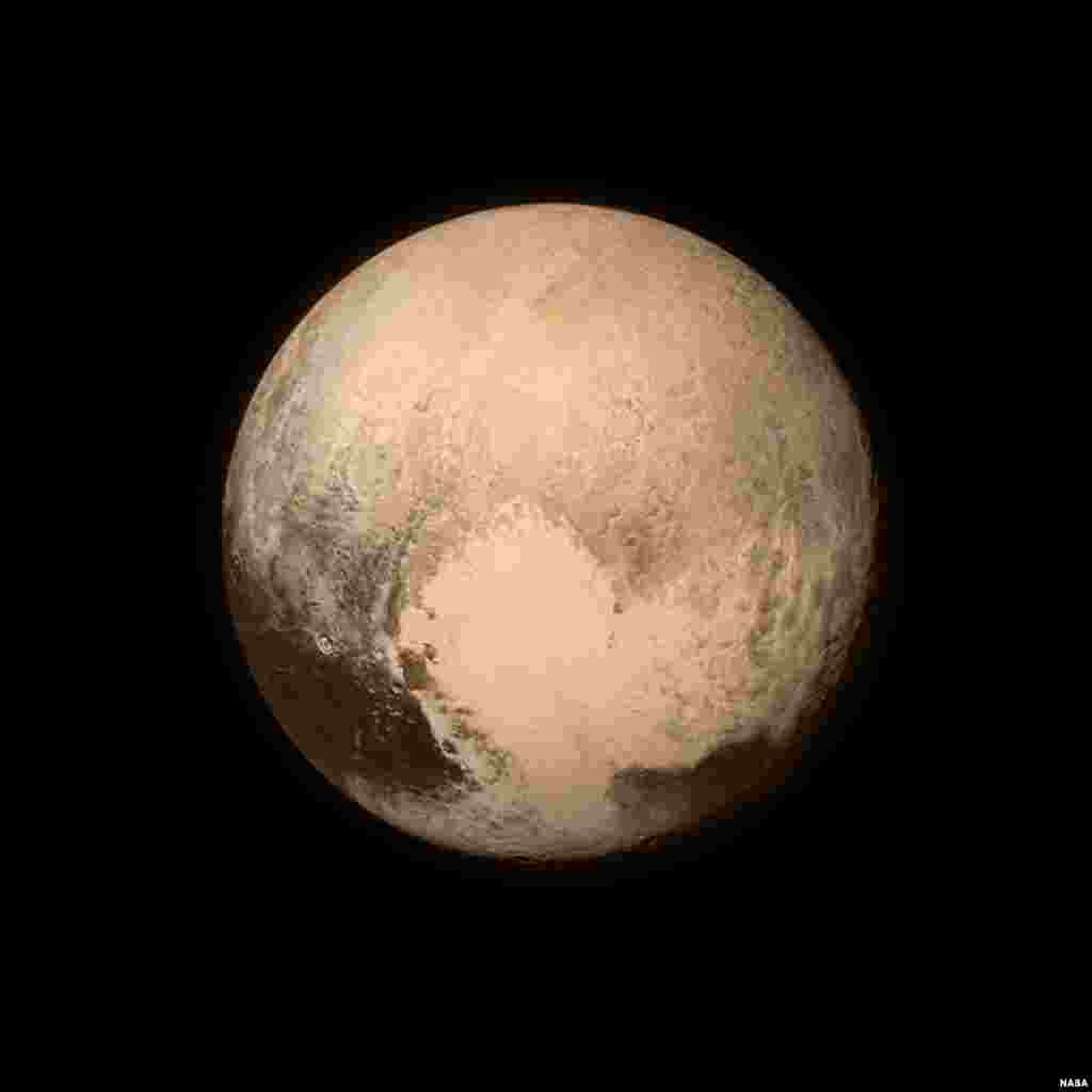 Pluto nearly fills the frame in this image from the Long Range Reconnaissance Imager (LORRI) aboard NASA's New Horizons spacecraft, taken on July 13, 2015, when the spacecraft was 476,000 miles (768,000 kilometers) from the surface. (CREDIT: NASA/APL/SwRI)