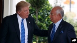 President Donald Trump greets Malaysian Prime Minister Najib Razak at the White House