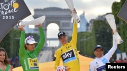 Chris Froome, center, celebrates his overall victory with Peter Sagan of Slovakia, left, and Nairo Quintana of Colombia after the final stage of the 102nd Tour de France in Paris, July 26, 2015.