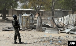 FILE - A Cameroonian soldier walks in the Cameroonian town of Fotokol, on the border with Nigeria, on Feb. 17, 2015, after clashes occurred Feb. 4 between Cameroonian troops and Nigeria-based Boko Haram insurgents.