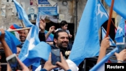 Lebanese prime minister and candidate for parliamentary election Saad al-Hariri greets his supporters in Beirut, Lebanon, May 4, 2018.