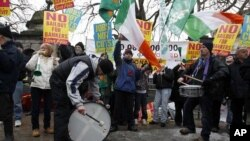 Demonstrators protest outside Government Buildings as the budget is announced, in Dublin, 07 Dec 2010