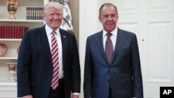 President Donald Trump meets with Russian Foreign Minister Sergey Lavrov, right, at the White House in Washington, May 10, 2017.