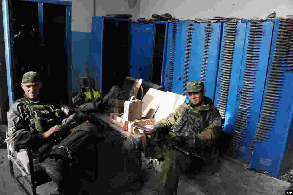 Pro-Russian separatist fighters take a break at Donetsk's Sergey Prokofiev international airport.
