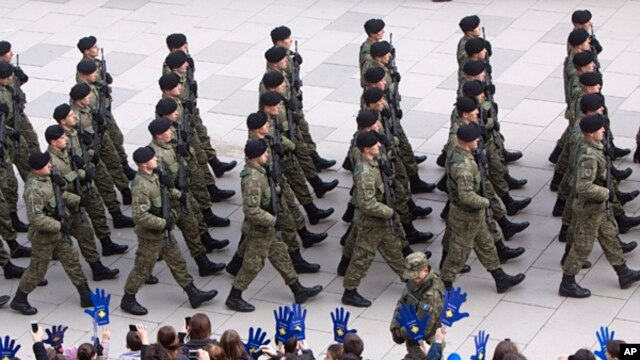 Kosovo Security Force members parade in the center of Pristina marking the 5th anniversary since Kosovo seceded from Serbia, Feb. 17, 2013.