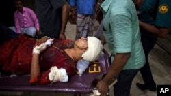 afida Ahmed, wife of a prominent Bangladeshi-American blogger, Avijit Raoy is being rushed to hospital on a stretcher after she was seriously injured by unidentified attackers, in Dhaka, Bangladesh, Feb. 25, 2015.