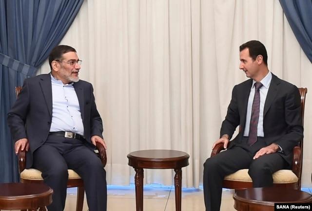 FILE - Syria's President Bashar al-Assad, right, meets Admiral Ali Shamkhani, Iran's Supreme National Security Council Director, in Damascus, Sept. 30, 2014.