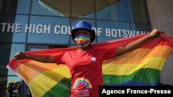 Activists carry a rainbow flag outside the Botswana High Court, Oct. 12, 2021.