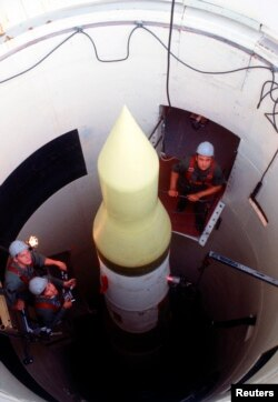 FILE - U.S. Air Force technicians perform an electrical check on an LGM-30F Minuteman III intercontinental ballistic missile in its silo at Whiteman Air Force Base, Missouri.