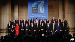 Foreign Ministers from NATO countries pose for a group photo during a ceremony to commemorate NATO's 70th anniversary at Mellon Auditorium in Washington, Wednesday, April 3, 2019.