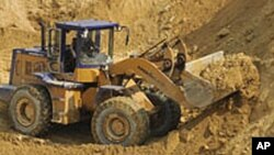 Escavadora em acção em Tete