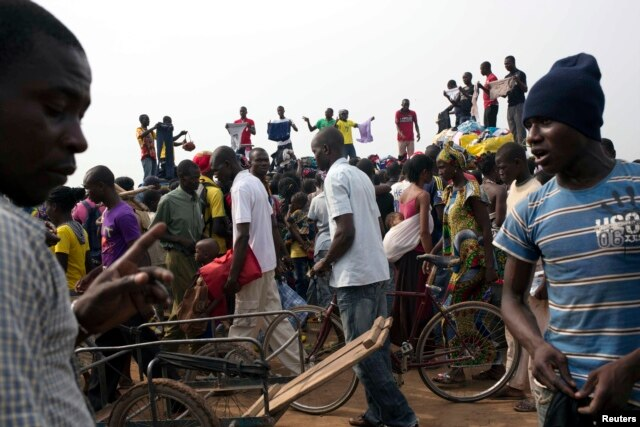 FILE - People sell clothes at the displaced camp at Mpoko international airport in Bangui, Central African Republic, Feb. 26, 2014.