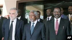 International Criminal Court Chief Prosecutor Luis Moreno Ocampo, left, former U.N. chief Kofi Annan, center, and Kenyan Prime Minister Raila Odinga, right, walk outside Crowne Plaza Hotel in Nairobi, Kenya, Dec 2, 2010