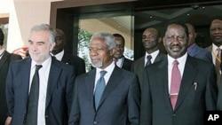 International Criminal Court Chief Prosecutor Luis Moreno Ocampo, left, former U.N. chief Kofi Annan, center, and Kenyan Prime Minister Raila Odinga, right, walk outside Crowne Plaza Hotel in Nairobi, Kenya, December 2, 2010
