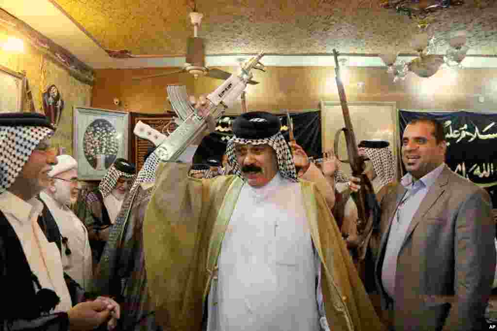 Iraqi Shiite tribal leaders chant slogans against the al-Qaida-inspired Islamic State of Iraq and the Levant (ISIL), in Baghdad, June. 13, 2014.