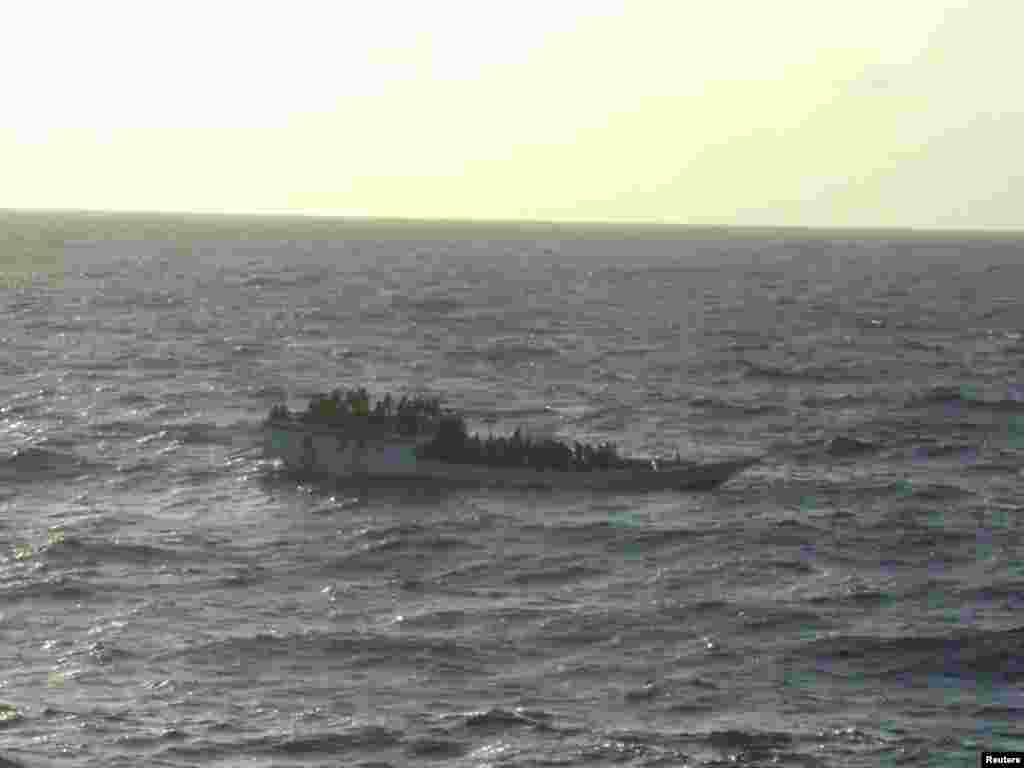 This boat, carrying about 150 suspected asylum seekers capsized June 27, 2012 between Indonesia and Australia's Christmas Island in the India Ocean, the second such incident in less than a week, highlighting Australia's struggle to stem the flow of boat people.