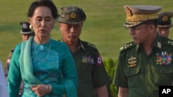 Aung San Suu Kyi, Myanmar's foreign minister and de facto leader (l) walks with senior General Min Aung Hlaing, Myanmar's commander-in-chief (r) in the airport of capital Naypyitaw, Myanmar on May 6, 2016.