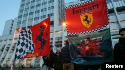 Ferrari flags are seen in front of the CHU Nord hospital emergency unit in Grenoble, French Alps, where retired seven-times Formula One world champion Michael Schumacher is hospitalized after a ski accident, Dec. 31, 2013.
