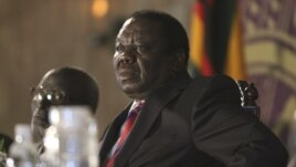 imbabwean Prime Minister Morgan Tsvangirai is seen during a meeting with President Robert Mugabe in Harare (file).