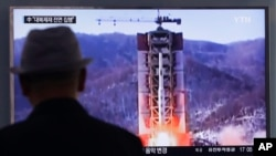 FILE - A man watches a TV news program showing a file footage of North Korea's rocket launch at Seoul Railway Station in Seoul, South Korea, April 28, 2016.