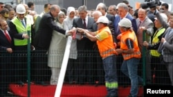 Turkey's Prime Minister Tayyip Erdogan (3rd L), his wife Emine Erdogan (4th L), President Abdullah Gul (6th L) and his wife Hayrunnisa Gul (5th L) attend a groundbreaking ceremony for the third Bosphorus bridge linking the European and Asian sides of Ista