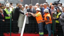 PM Erdogan (3rd L), his wife Emine (4th L), President Abdullah Gul (6th L) and his wife (5th L) attend a groundbreaking ceremony for the third Bosphorus bridge, May 20, 2013.